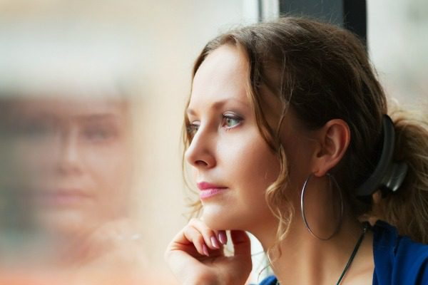 Calm woman looking out a window