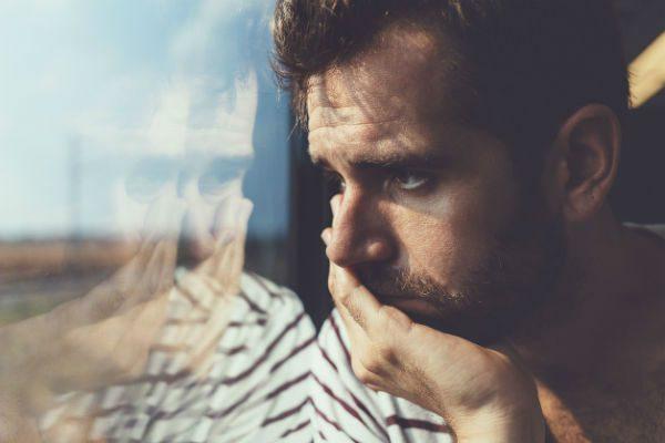 Anxious man by window