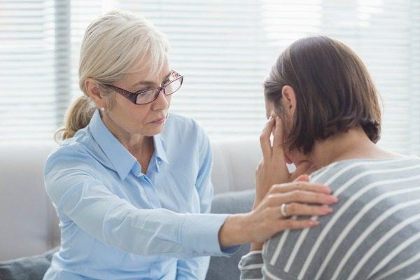 Female counselor with patient