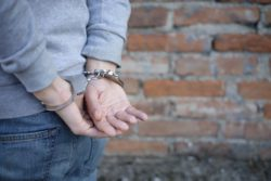 man's hands in handcuffs