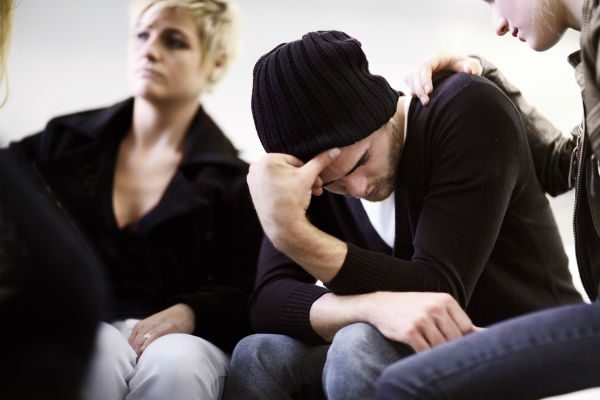 Heroin addict being comforted