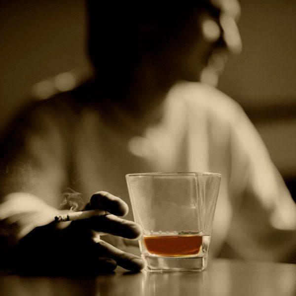 Man drinking alone