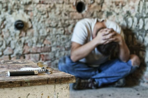 Overdose man crouching