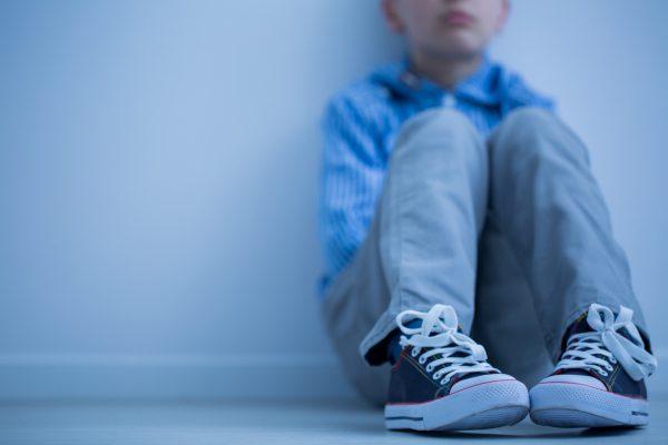 Sad boy sitting alone