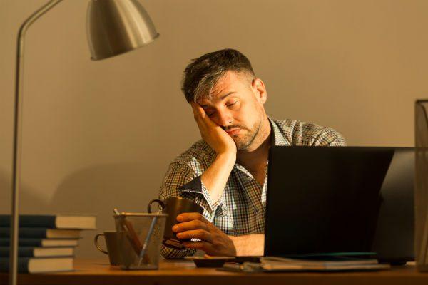 Sleepy man at computer