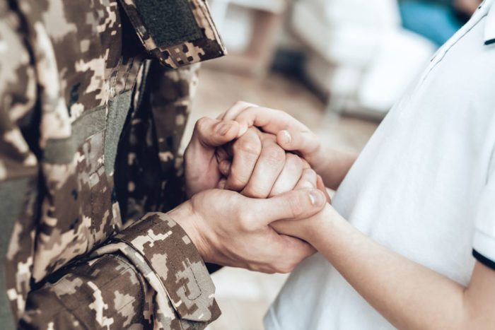 Veteran Home Holding Hands