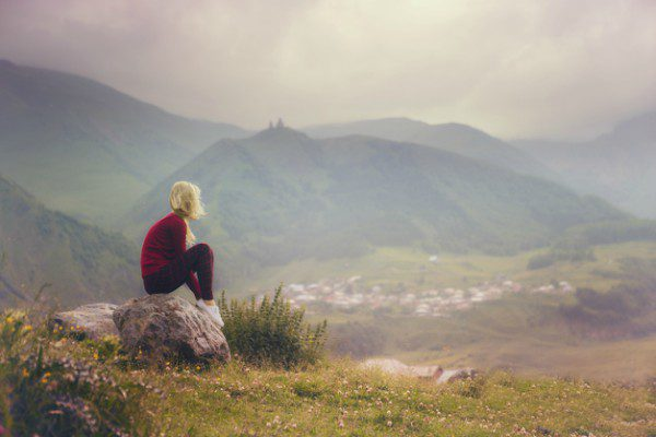 Woman alone in the mountains